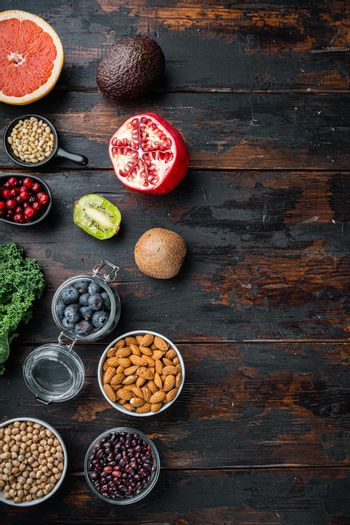 Healthy food clean eating selection, top view on dark wooden background, with copy space