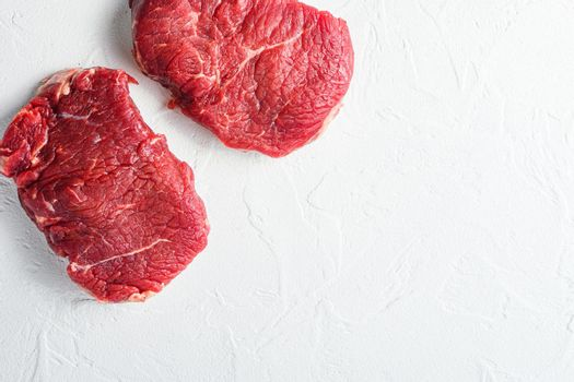 Rump steak, farm organic raw beef meat White textured background. Top view space for price.