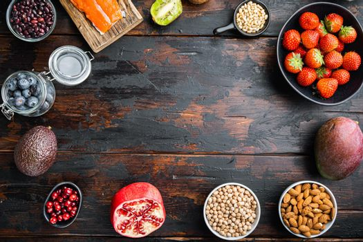 Healthy food clean eating selection, frame concept, top view on dark wooden background, with copy space