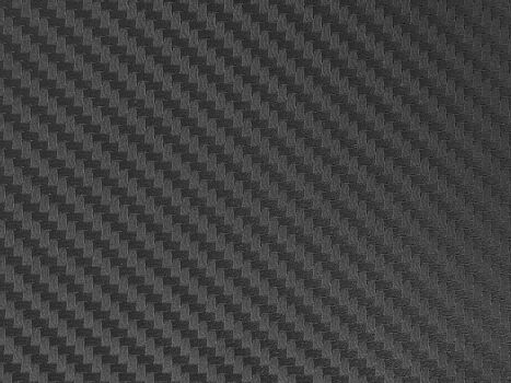 black kevlar pattern an abstract texture background by closeup surface of metallic or plastic composit costing