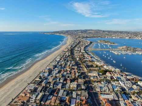 Aerial view of Mission Bay and Beaches in San Diego, California. USA. Community built on a sandbar with villas, sea port and recreational Mission Bay Park. Californian beach lifestyle.