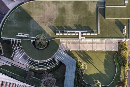 Bangkok, Thailand - 02 Jan 2020 : Top down aerial view of outdoor Green garden and Golf Driving Range surrounding palms in the condominium. Modern landscape architecture. No focus, specifically.