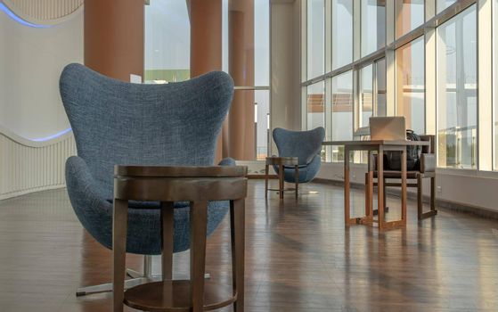 Bangkok, Thailand - Jan 14, 2021 : The new normal for common area in condominium. The seats were set separately according to social distancing policy for the spread of covid-19 prevention. No focus, specifically.