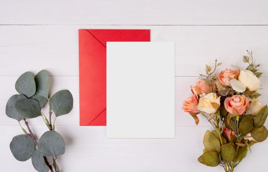 Valentine day, greeting card mockup and letter and flower on wooden table, postcard blank and letter with romance on desk, present in anniversary and celebration, top view, holiday concept.
