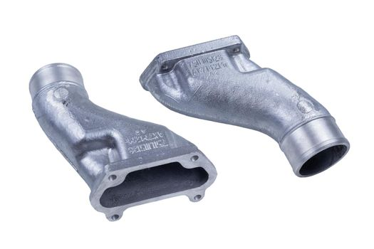 parts for connecting the intake manifolds of the Russian truck engine are isolated on a white background. front and rear view
