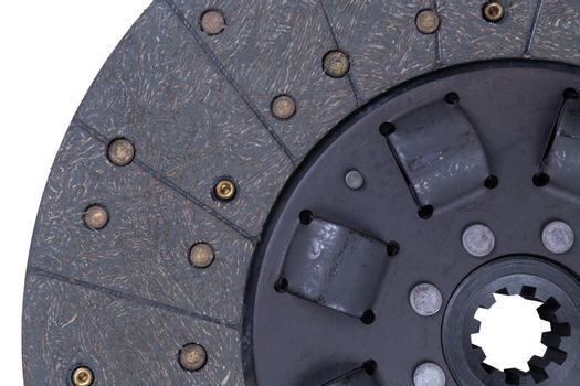 Close-up image of a car part, brown clutch disc isolated on a white background.
