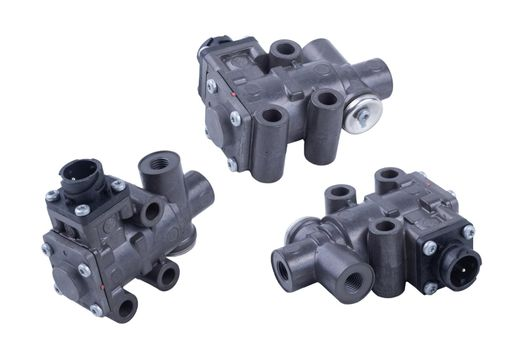 pneumatic valve for truck brake system on isolated white background. set of three parts