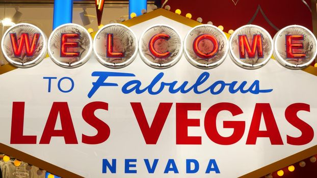 Welcome to fabulous Las Vegas retro neon sign in gambling tourist resort, USA. Iconic vintage glowing banner, symbol of casino, games of chance, money playing and hazard bets. Illuminated signboard