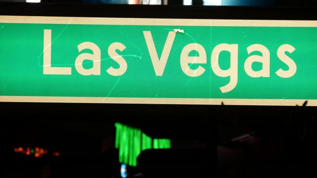 Fabulos Las Vegas, traffic sign glowing on The Strip in sin city of USA. Iconic signboard on the road to Fremont street in Nevada. Illuminated symbol of casino money playing and bets in gaming area