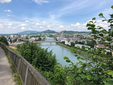 Train passing by over the Salzach river