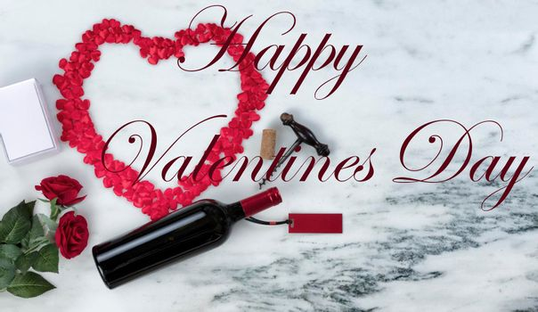Happy Valentines Day with lots of romantic gifts on marble stone background including text