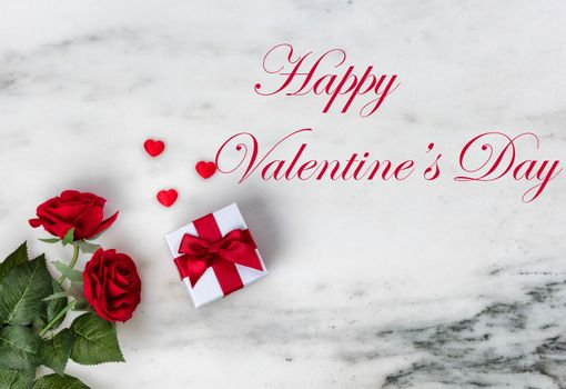 Happy Valentines Day with lovely rose flowers and giftbox on natural marble stone including text