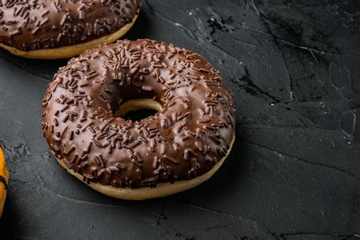 Homer donuts chocolate, on black background with copy space for text