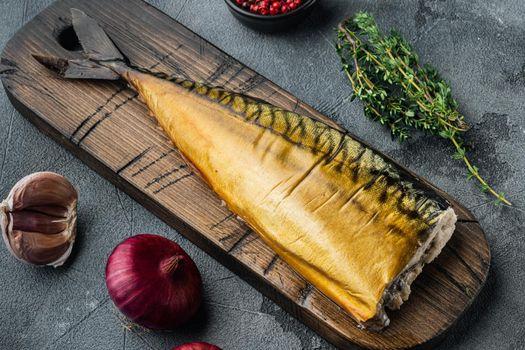 Appetizing smoked fish, on gray background