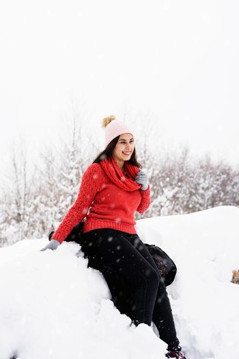 Portrait of a beautiful smiling young woman in wintertime outdoors