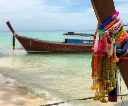 Long-tail boats at beach on Koh Ngai