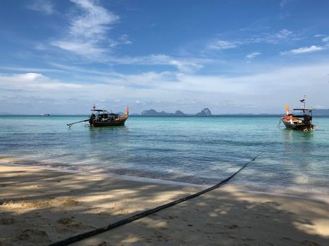 Long-tail boats close to the beach