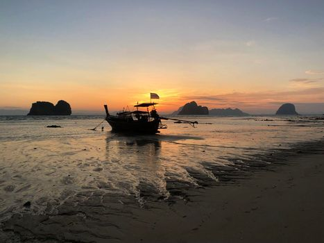 Long-tail boat during sunrise