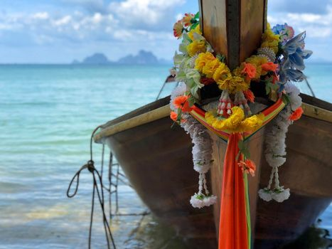 Colorful clothes tied to the bow of long-tail boat