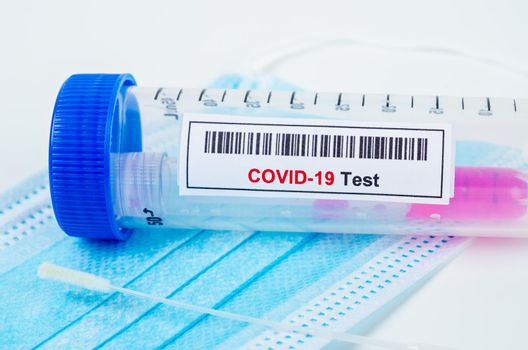 Tube containing nasopharyngeal swab for coronavirus or COVID-19 test.