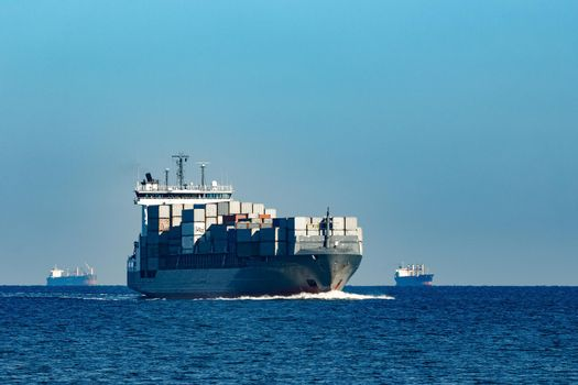 Large grey container ship moving from Baltic sea