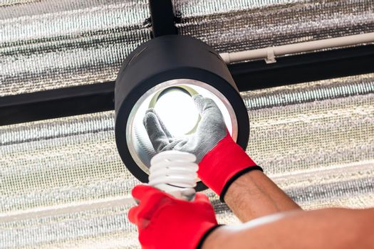 Replace the broken fluorescent light bulbs with LED bulbs.