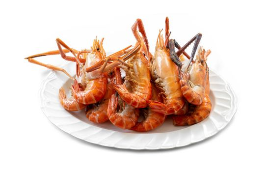 Several large river prawns grilled and placed on a plate are ready to eat on white background.