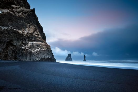 Beautiful Landscape of a Famous Black Pebbles Beach. Amazing View on the Basalt Cliffs in the Sea. Vik Myrdal. Iceland