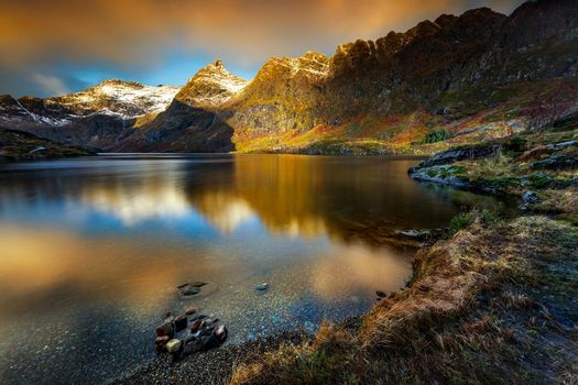 Picturesque Landscape of Lofoten Islands in Mild Sunset Light. Beautiful View of the Majestic Mountains Stretched Around the Lake. Gorgeous Norway Nature.