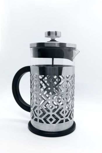 Clear Press Coffee Maker Isolated on White. French Press in Stainless Steel with Removable Borosilicate Glass Flask for Hot Cold Drinks. Modern Small Domestic Kitchenware. Vessel for Filtering Blend