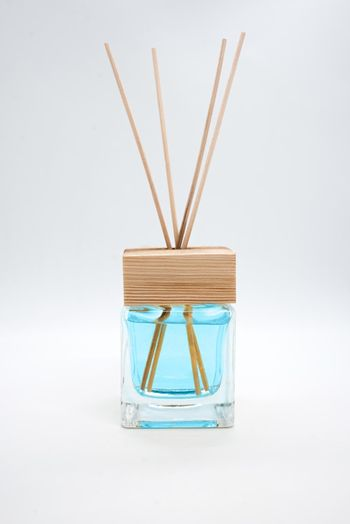 A Bottle of Lavender Fragrant Oil Diffuser with Reed Sticks, isolated on white