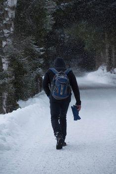 trekking in the alps in a snowy white winter landscape
