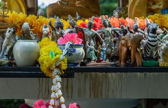 Thai dancing dolls, Zebra doll and Wooden elephant doll in The Thao Maha Phrom Shrineis.