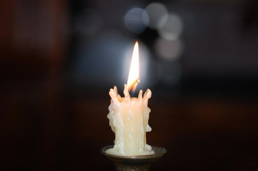 White candle on a candlestick in the center.