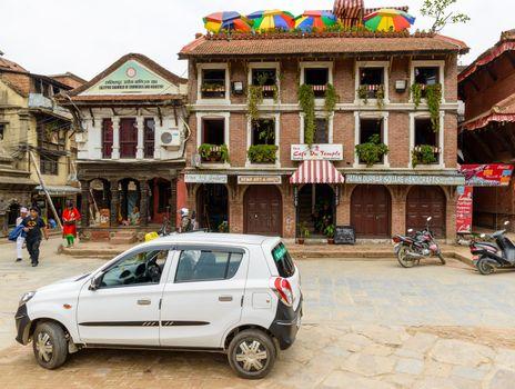 A Suzuki Maruti taxi and the Cafe du Temple on Patan Durbar Square.