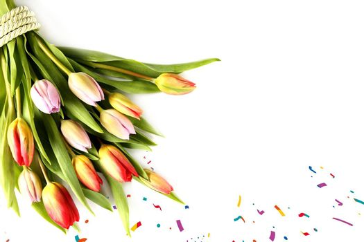 Bunch of spring flowers. Fresh tulips on white background. Valentines, Easter, Birthday, Love, marriage, wedding card. Isolated on white