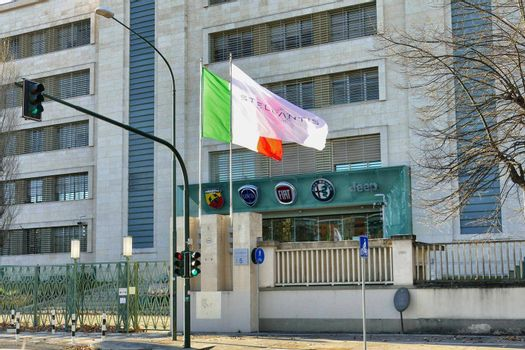 Stellantis corporation flag at italian headquarters after merging between Groupe PSA and FCA automotive Turin Italy January 25 2021