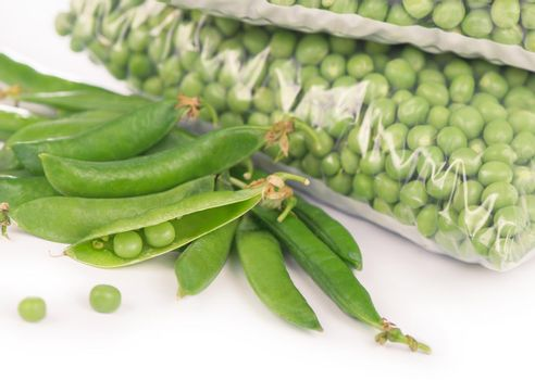 green peas cooked for freezing on a white