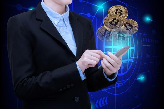 Business woman use smartphone technology invest in Bitcoin.