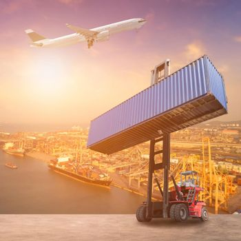 Logistics and transportation of Container Cargo ship, Cargo plane and Forklift truck work in shipping yard. Photo concept for global business containers shipping,Logistic,Import and Export industry.