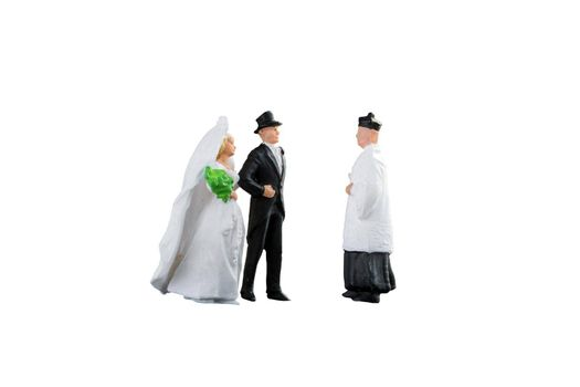 Close up of Miniature people wedding bride and groom couple isolated with clipping path on white background.Elegant Design with copy space for placement your text, mock up for love and wedding concept
