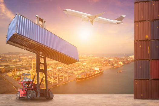 Logistics and transportation of Container Cargo ship, Cargo plane and Forklift truck work in shipping yard. Photo concept for global business containers shipping,Logistic,Import and Export industry