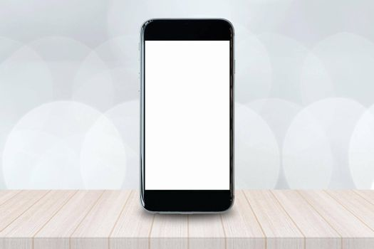Smartphone with blank white screen and copy-space on wood table. Elegant Design with Copy Space for placement your background,Template mock up for montage your design and products