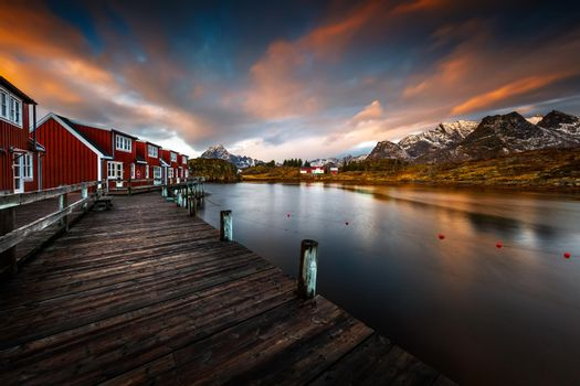 Beautiful Landscape. Peaceful Morning on the Islands of Lofoten. Typical Red Houses Settlement with Wooden Pier. Amazing Scandinavian Nature. Norway.