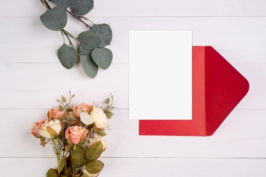 Valentine day, greeting card mockup size a5 and letter and flower on wooden table, postcard blank and letter with romance on desk, present in anniversary and celebration, top view, holiday concept.