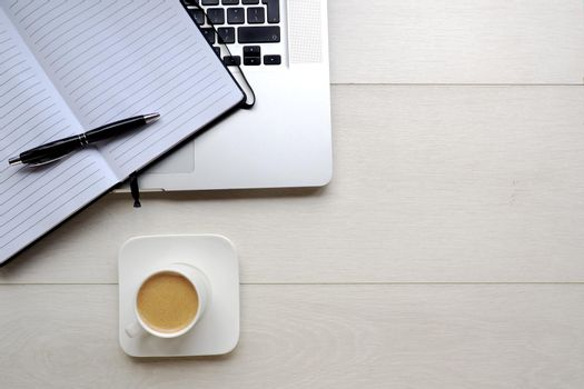 Coffee and notepad with computer