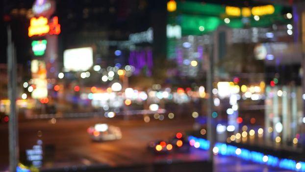 Defocused fabulous Las Vegas Strip boulevard, luxury casino and hotel, gambling area in Nevada, USA. Nightlife and traffic near Fremont street in tourist money playing resort. Neon lights of sin city