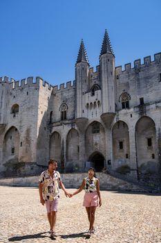 couple visit Avignon, Provence, France, men and woman mid age visit Avignon Provence France
