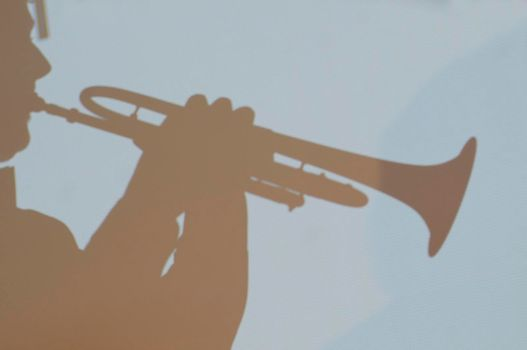 playing the trumpet, a brass instrument, musical instrument in art and culture