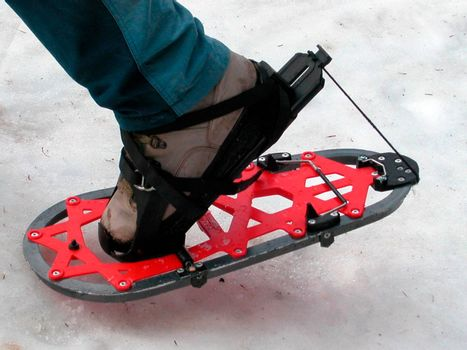 hiking with snowshoes in winter, outdoor sports in the mountains